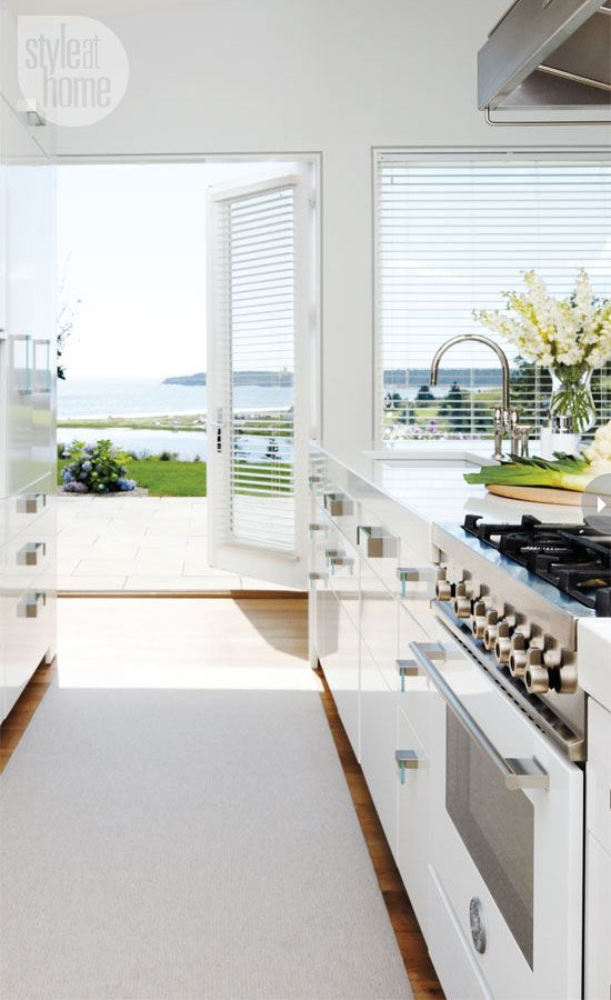 Kitchen Dreams. French doors open to backyard terrace. Interior Designer: Laura Fisher.