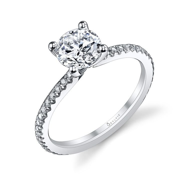 Style# S1093 Classic Solitaire Diamond Engagement Ring - This timeless and classic solitaire engagement ring features a dazzling 1 carat round brilliant diamond in a prong setting and placed upon a shank accented with a total weight of 0.21 carats of cascading pave diamonds. https://www.sylviecollection.com/classic-solitaire-diamond-engagement-ring-s1093