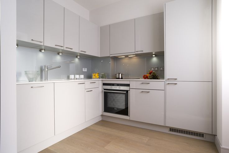 Charles Baker Place, Wandsworth.  Urban Life Light Grey Gloss units with Blanco Stone Worktop.