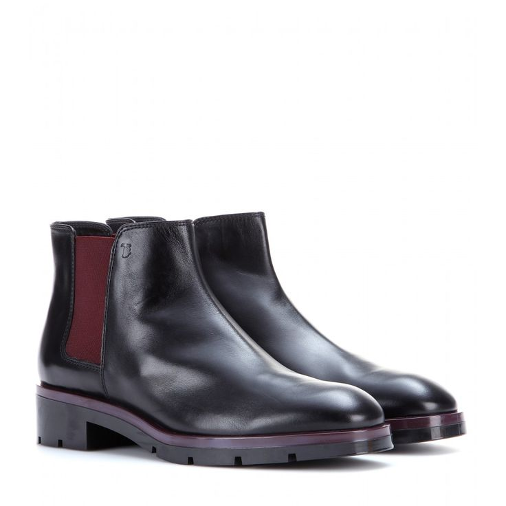 Tod's - Leather chelsea boots - The appeal of Tod's shoes is in the high-quality textures and versatile silhouettes, as proven with these leather Chelsea boots. Hard-working but luxurious, the jet black colour is made exciting with a deep plum contrast. seen @ www.mytheresa.com