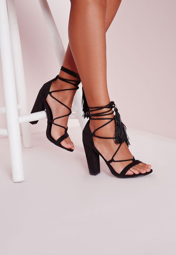 We're totally lusting over these fierce black heeled sandals. Featuring lush black faux suede, seductive lace up detail which can be wrapped around your ankle and on trend tassel trim to each lace. Wear with a killer mini dress to ensure al...