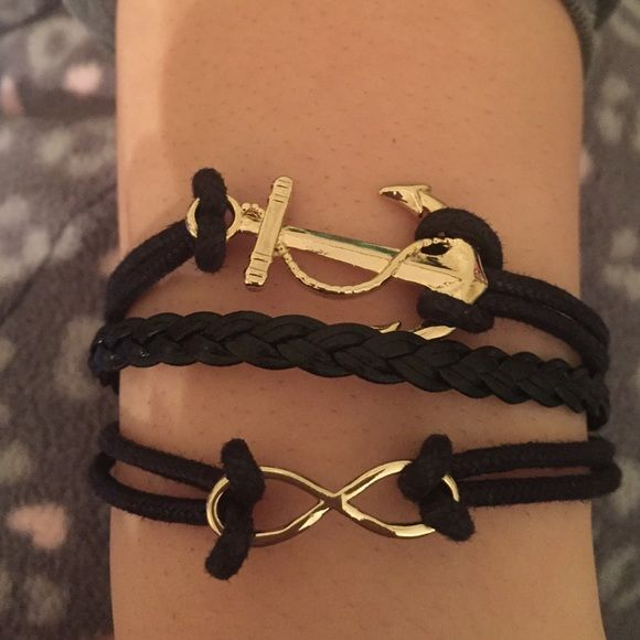 Layered black leather with gold detail bracelet Gold anchor and infinity sign detailed bracelet with black leather straps Betsey Johnson Jewelry Bracelets