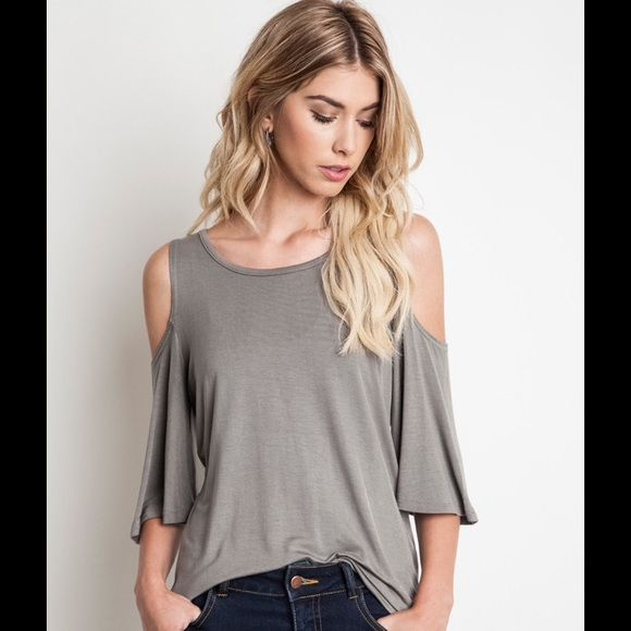 Fabulous khaki cold shoulder top !  The softest knit and so sexy with the cold shoulder! Love it! Sizes Small , Medium, Large ( note colors in each size ! Message me with size and color and I'll tag you in a listing ! tradesPayPal Bundles welcome! Black: 2 (S).     Ivory:1(S), 2(M), 2(L).    Khaki:1(S),2(M),  1(L) Boutique Tops Tees - Short Sleeve