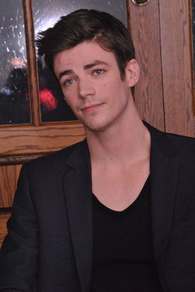 Grant Gustin at a press conference for The Flash at the HFPA Offices in West Hollywood