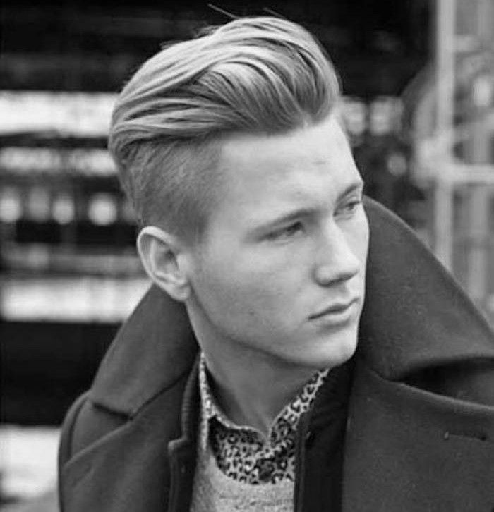 hairstyles for medium length hair, blonde young man with disconnected undercut and pompadour, wearing dark winter jacket