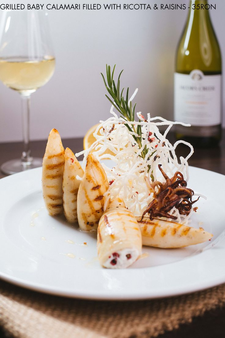 Grilled Baby Calamari filled with ricotta and marinated raisins - simply mouthwatering Wine pairing: Chardonnay