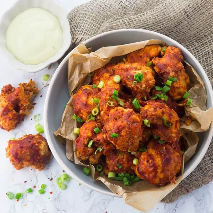 These vegan cauliflower hot wings with vegan aioli are the perfect comfort food! It's almost a bit creepy how close they are to the real thing!