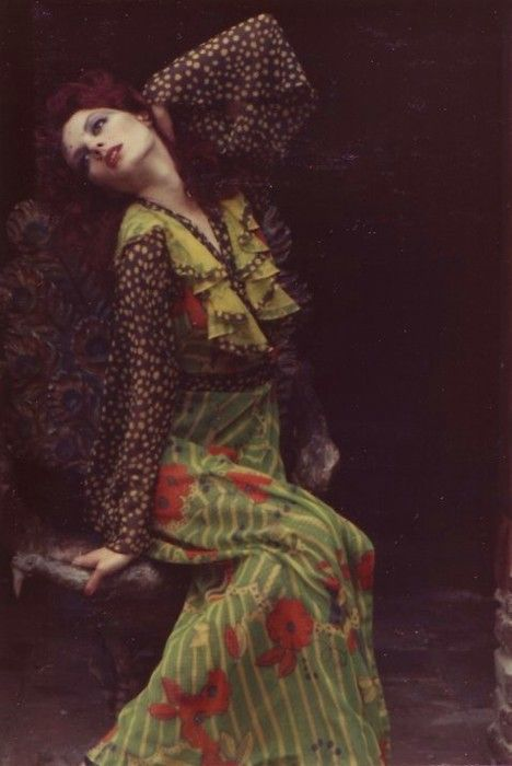 Gala Mitchell wearing Ossie Clark/Celia Birtwell print 70s fashion style designer color photo print ad long flowing green red floral dress