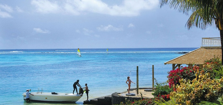 Stepping from the boat at Le Cannonier Hotel, Mauritius