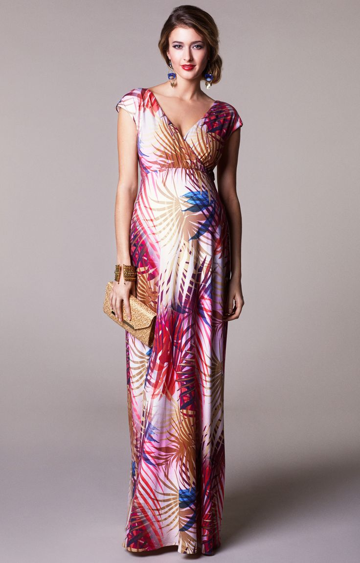 Be on trend in warm, summer hues wearing our new tropical leaf print Alana maternity maxi dress.