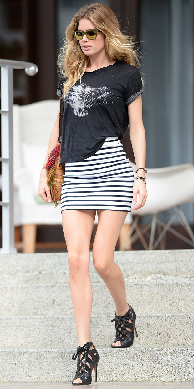 Doutzen Kroes donned a stripped mini-skirt and a black graphic t-shirt as she made her way out into the busy city of Miami.