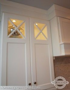 Criss Cross Mullions.  This style is more for transitional kitchens.  They make great accents in this white kitchen.