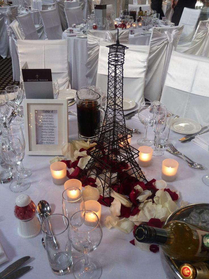 Eiffel Tower centrepiece with red and white rose petals. Styled by Greenstone Events.