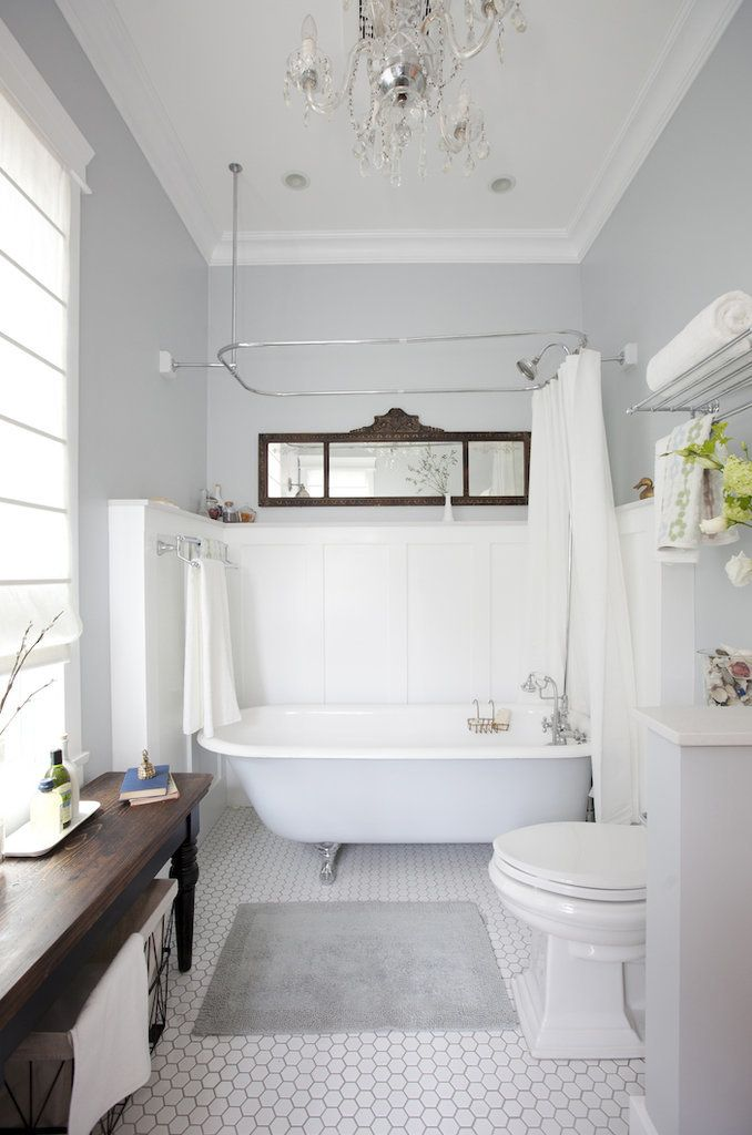 Simple elegance is the name of the game in this elegant-glam white and grey bathroom.