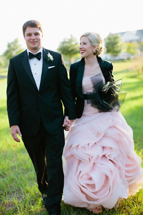 pink wedding gown with black sash and tux jacket! photographed by top wedding photographers Kallima Photography | junebugweddings.com