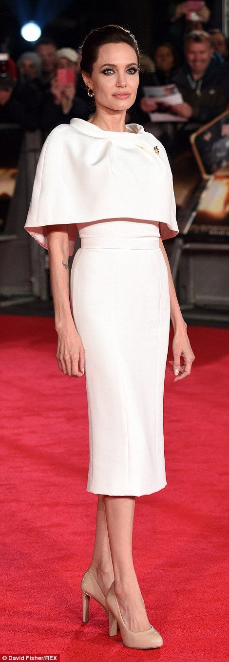 Demure: The mother-of-six cut a regal figure on the red carpet in her sophisticated dress...