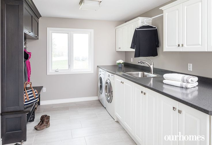 "A long counter and lots of storage in the laundry room means everyone gets a chance to get their laundry clean, organized and folded.   See more of this home in ""Love Letter to a House That's Grown With Its Family"" from OUR HOMES Wellington Holiday/Winter 2016/2017 http://www.ourhomes.ca/articles/build/article/love-letter-to-a-house-thats-grown-with-its-family"