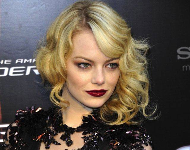 Emma Stone's dark lips! Right on trend for fall. Try a deep burgundy shade.Emma Stone
