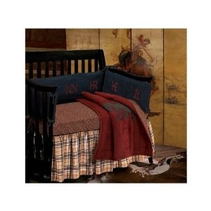 Simple western crib set by Wrangler with cattle brands.