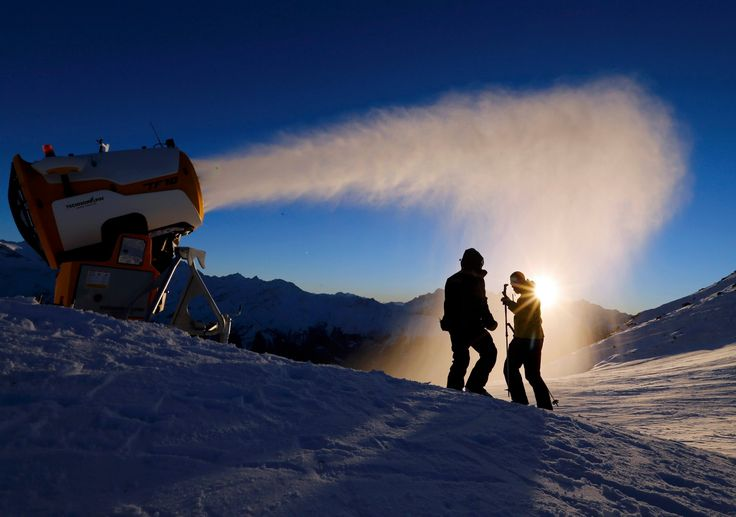 Verbier, Switzerland. Snowmakers of the Verbier ski resort check the artificial snow making machine