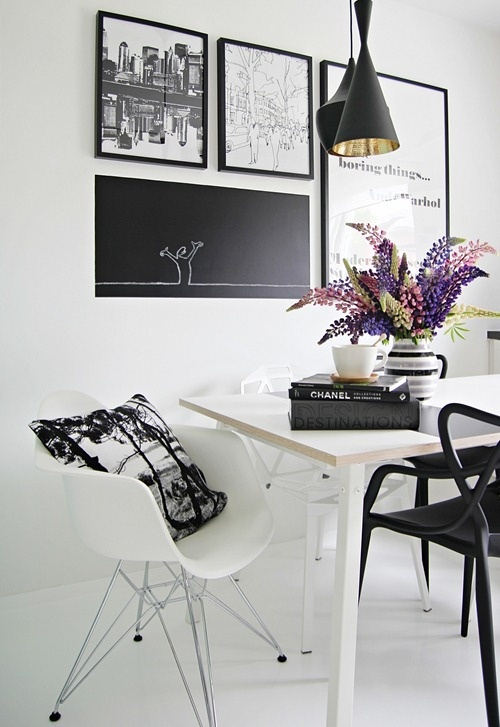 black and white dining. black and gold pendant lamp.