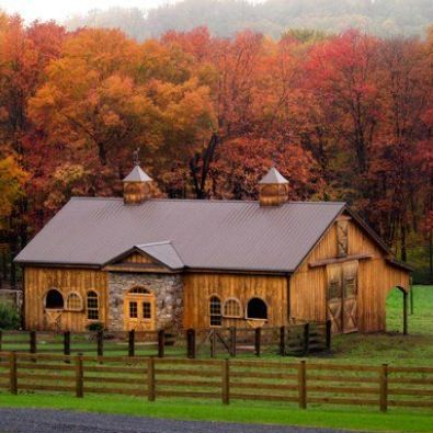 I like this stone and wood exterior with a tin roof, overhang on the side inside the pasture, stall doors with top halves that swing open to the outside and the overall class of this barn. Plus, huge drive in doors on the right would make storing hay or moving hay from that spot very slick #provestra