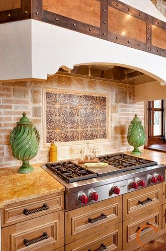 Spanish Style :: view 6 of 7 ... elegant mix of materials at cooktop/range-hood  *brick *granite *decorative tiles *copper *brass