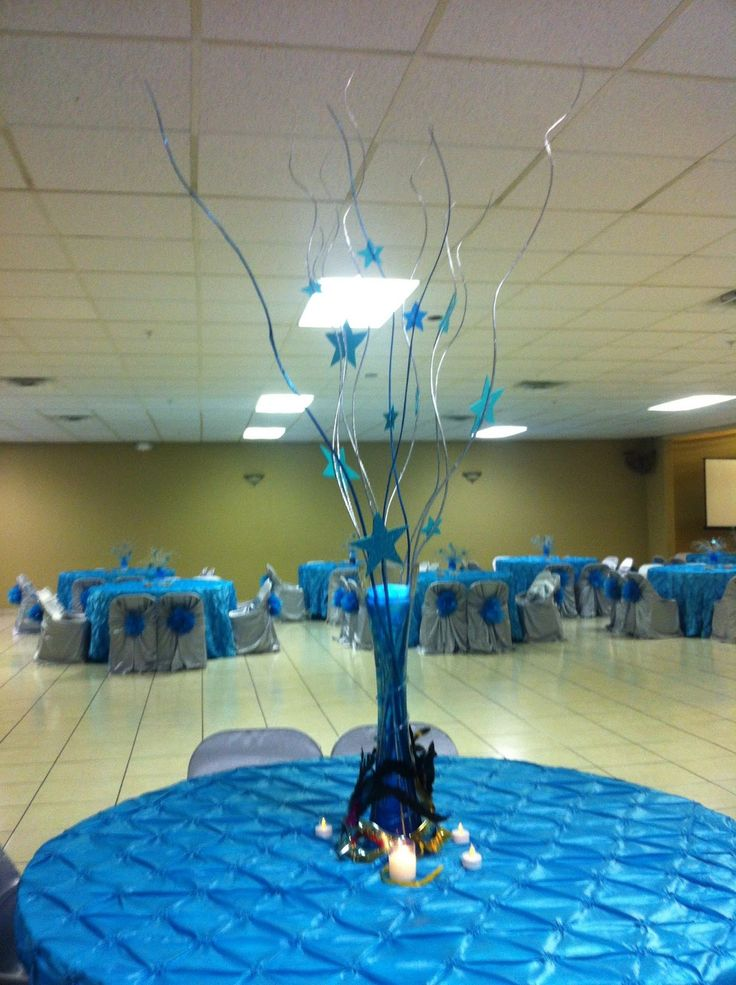 quinceanera hall and Table Decorations   This themed center piece goes according to the theme of the party and ...