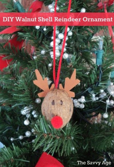 Fun and easy DIY Reindeer Ornament. Use walnut shells for this cute homemade ornament. Christmas Craft for the dollar store!