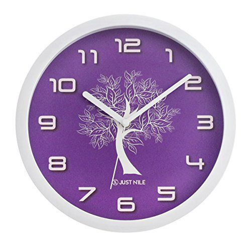 """JustNile Silent Modern Creative White Frame Wall Clock - 10-inch Purple Clock Face W/ White Tree:   This 10"""" modern wall clock with a white frame and white tree pattern on purple dial adds a nice touch to any home design. With a silent and smooth sweeping movement of the clock hands, you can be assured of a peaceful environment for your work or rest time. Easy to maintain and clean. One AA battery required (not included)."""
