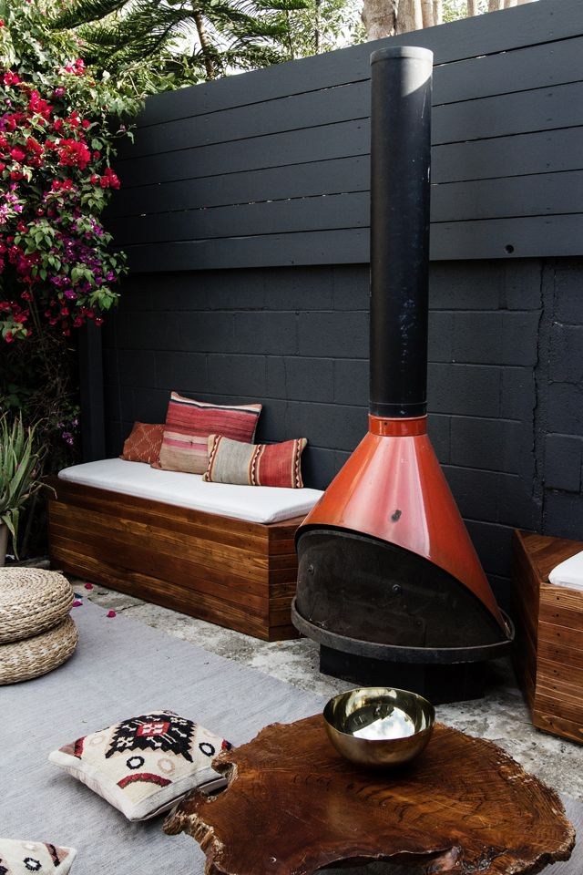 outdoor living space with stovepipe fireplace