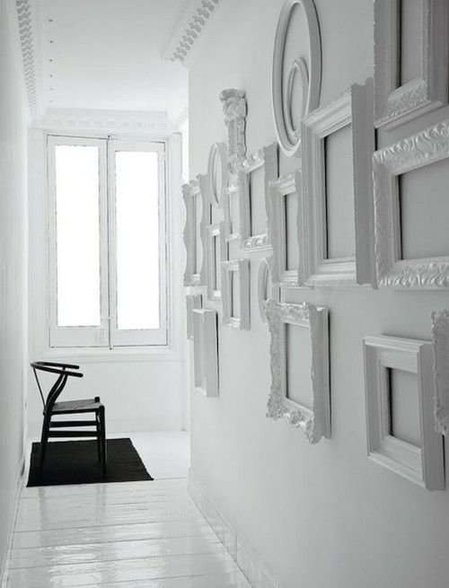 love the contrasting black chair in this white space