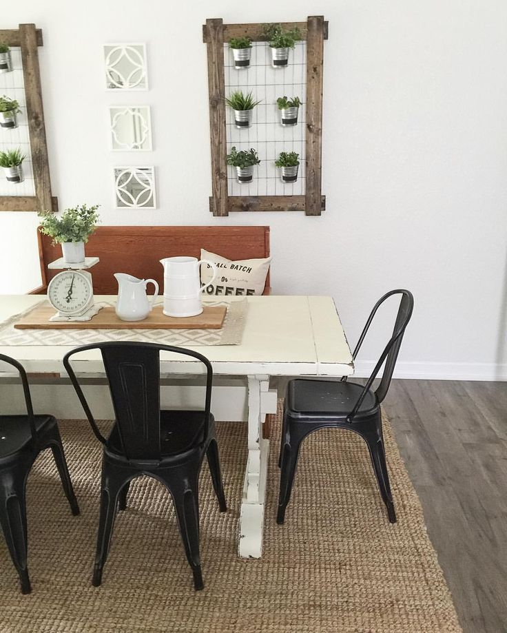 white farmhouse table. Black metal chairs. Farmhouse