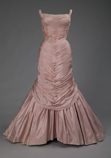"""Charles James """"Tree"""" dress    The name of the dress does not refer to the beautiful bark-like ruching it displays, but is instead probably a reference to one of the earlier purchasers of the design, a Mrs. Tree."""
