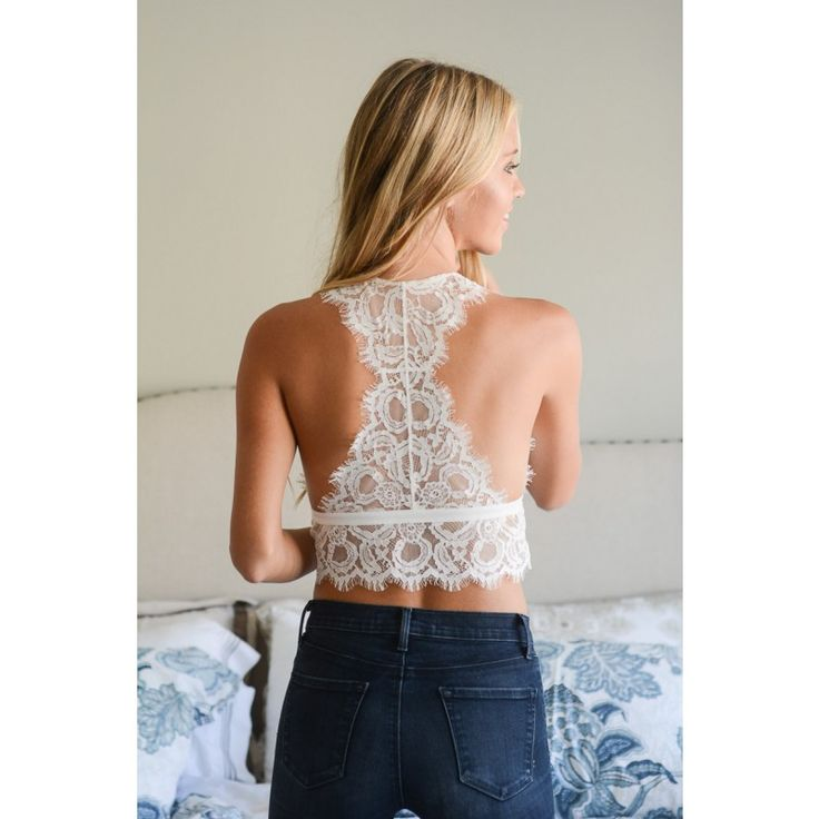 This dreamy little bralette is both dainty, and delicate featuring a racerback style. The bottom of the bralette falls just below the rib-cage, and could very well pass for a cute top at the beach with high waisted bottoms. This piece looks great beneath the Hopeless Romantic Blouse, but will also pair well with rompers and other tanks. The 'All of My Love Bralette' comes in bright white. Because of this item's coloring, you may need to wear breast petals, or concealers beneath it…