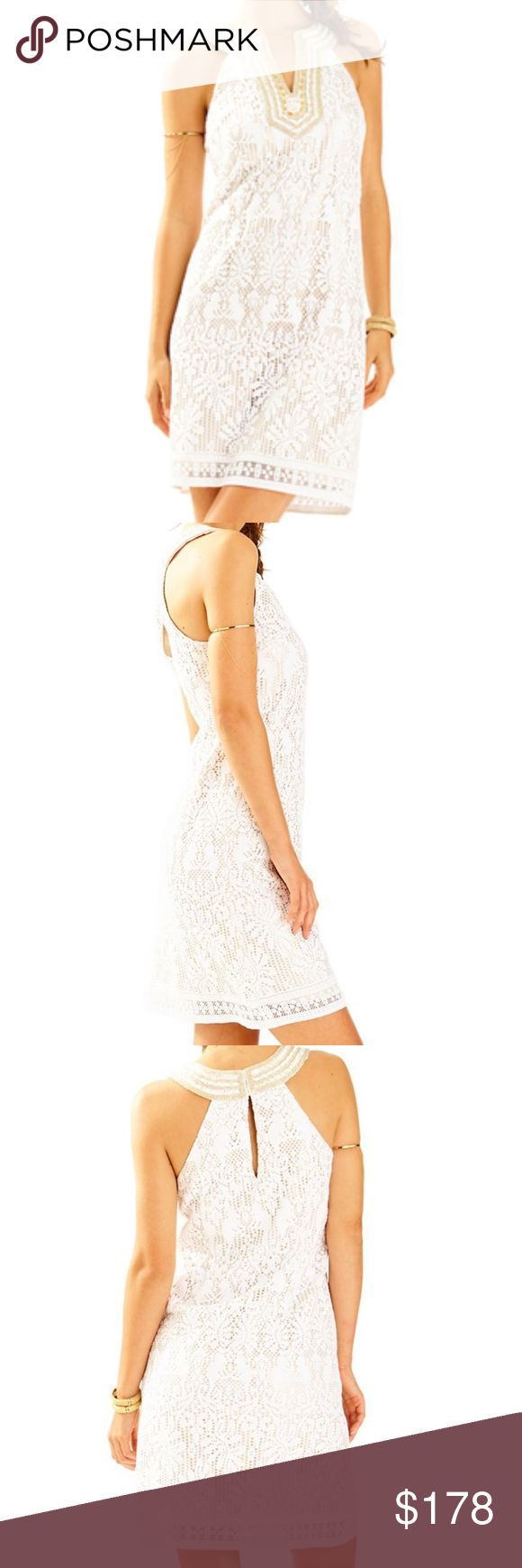 "LILLY PULITZER Calera Shift Dress in White NWT! LILLY PULITZER Calera Shift Dress in White  The Calera Shift is much more than your average white dress. This easy gold and white shift comes in an engineered jungle lace, has an embellished notch neckline with beading, and a hook and eye back.  Easy Shift Dress With An Embellished Notch Neckline. 37"" From Top Of Shoulder To Hem. Length: Knee Length. Engineered Jungle Lace (80% Cotton, 20% Polyamide). Hand Wash Cold. Separately. Imported. Style…"