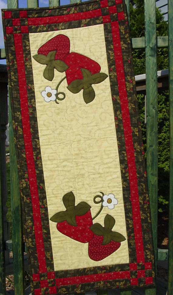 Quilted table runner with strawberries