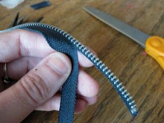 New use for old zippers - Bracelets! Seeing this picture also made me wonder if I could replace a broken zipper by cutting off the teeth & sewing a new zipper to the old seam binding??? (Mar'12)