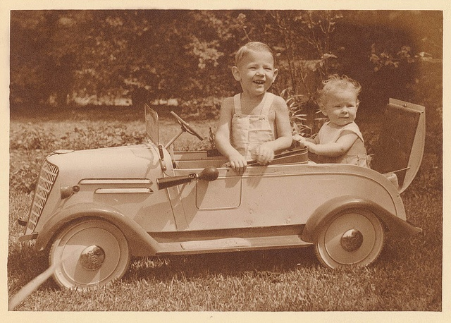 Boy in pedal car with baby in rumble seat, Sydney, ca. 1935 / photographer Sam Hood