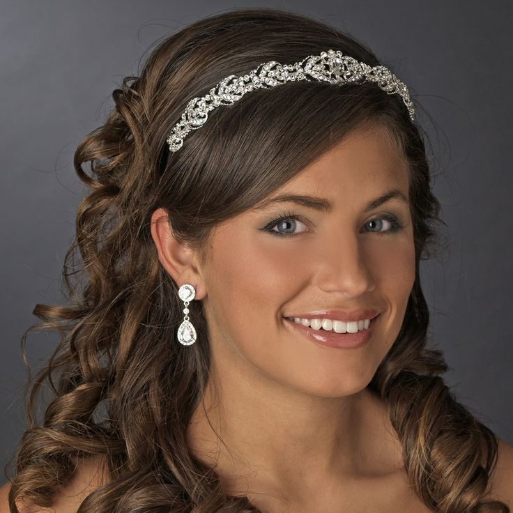 Vintage Bridal Headband. This beautiful vintage inspired designed bridal headpiece is encrusted with glistening rhinestones and features a glorious sparkling oval crystal at it's center. The perfect bridal headband for your glamorous vintage inspired look. http://oneclassicwedding.com/For-The-Bride/Bridal-Tiara-Headband/Vintage-Bridal-Headband
