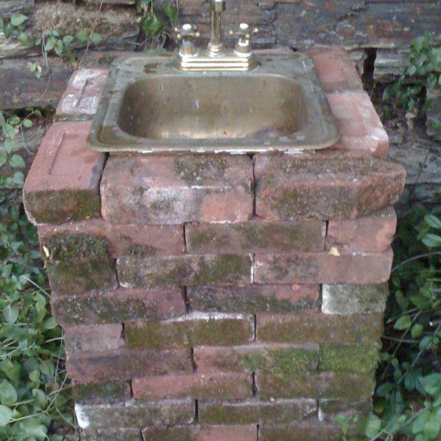 My outdoor sink made from savaged bricks, brass sink, and garden hose! www.placervillebedandbreakfast.com