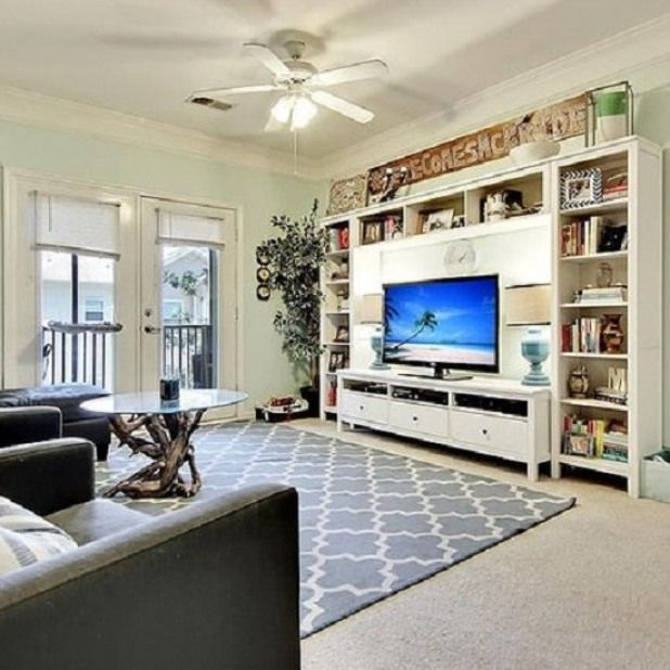 Small Apartment Living Room The Use Of A Compact Entertainment Center Makes The Most Small Apartment Living Room Small Apartment Living Apartment Living Room