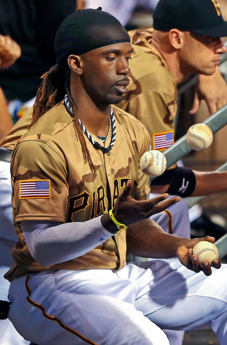 IN THE AIR Pittsburgh Pirates Andrew McCutchen juggles baseballs as he sits in the dugout as his team bats in the fifth inning of a game against the Houston Astros, Saturday, May 18, 2013, in Pittsburgh. (Keith Srakocic/AP)
