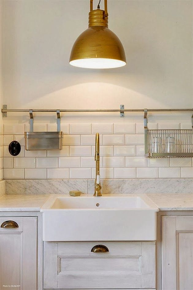 Baskets on rail over sink.. think similar hardware might be at ikea.