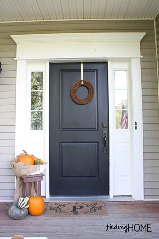 paint color, white trim and dark door..framing for outside of front door....
