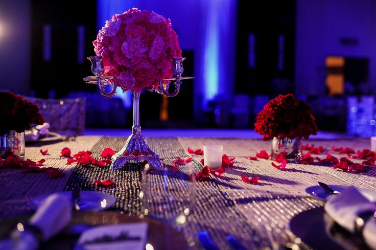 Our clients Hindu Wedding at Playacar Palace, Mexico. Reception Set-up; pink and red floral centerpieces