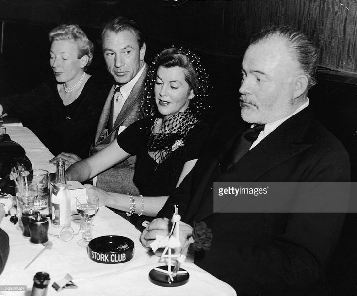 Martha Hemingway, actor Gary Cooper, his wife Veronica Balfe and author Ernest Hemingway sit in a booth at the Stork Club, New York City, 1943. Cooper starred in the film adaptation of Hemingway's novel, 'For Whom The Bell Tolls.'