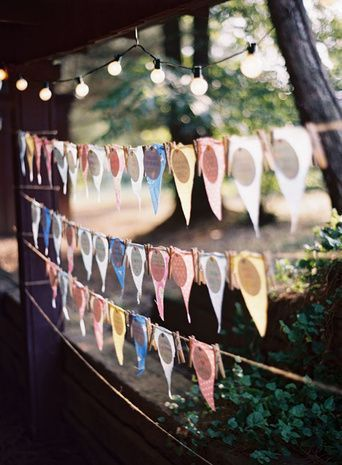 Fasten cards to a pennant banner for a festive presentation. {Tec Petaja Photography}: