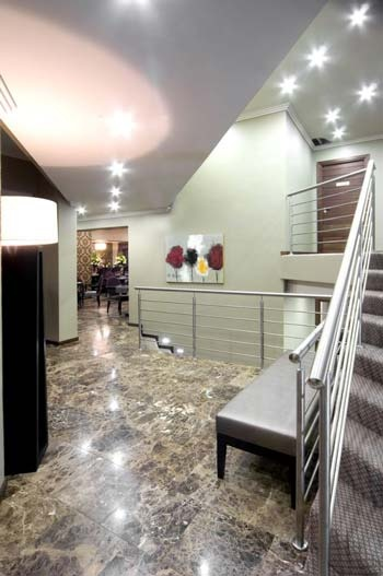 #Marble, combined with strategic downlighting and elegant #chrome balustrades, offers chic sophistication. #UnionTiles