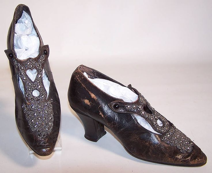 c.1900s Black leather shoes  with steel cut beads and heart shape cutout.  Via 1869-1960.com #xs0174